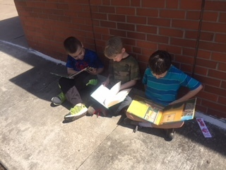 Students enjoyed reading outside on a warm day!