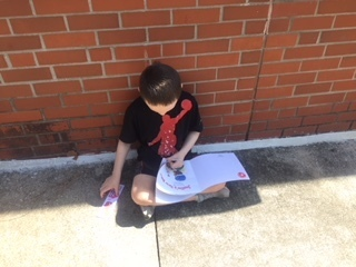 Students enjoy reading outside.