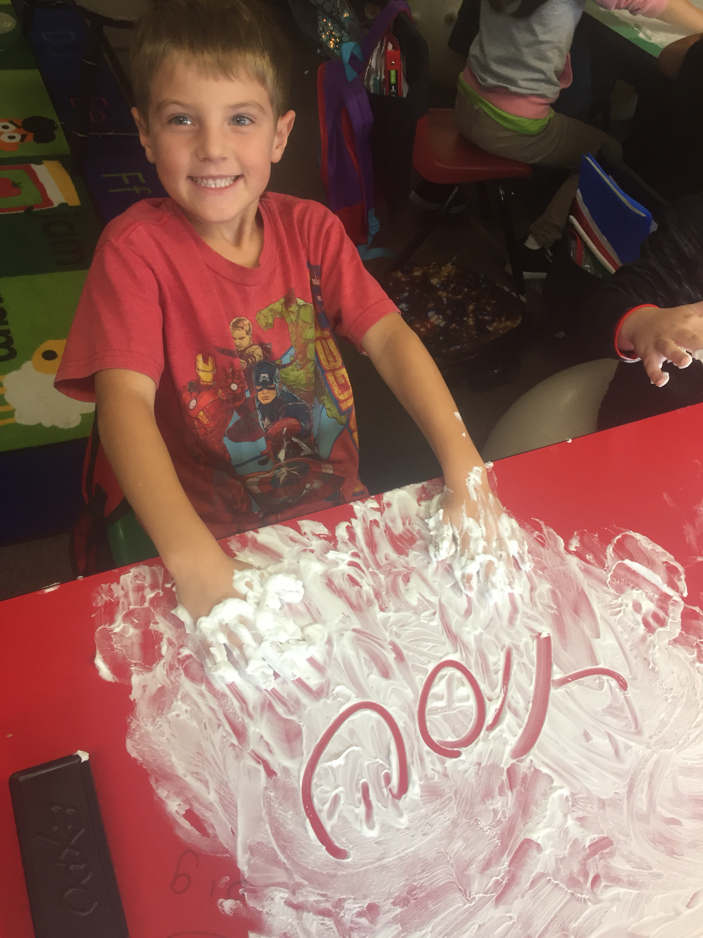 1st graders practicing sight words with shaving cream during OWL time!